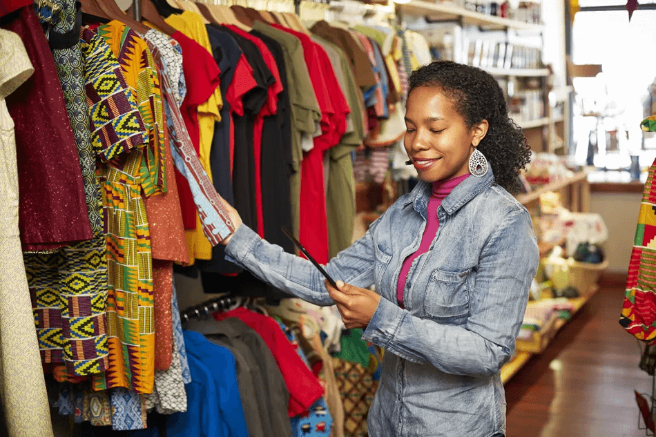 black-woman-working-in-store-594828875-5ab1654a8e1b6e0037623258
